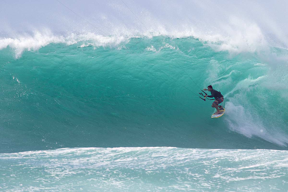 Reo Stevens kitesurfing at Off The Wall, Hawaii