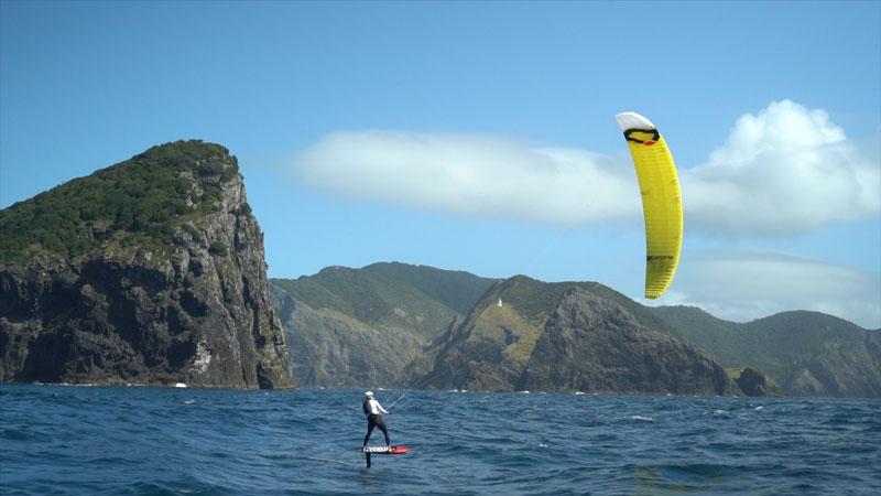 Sam Bullock kites around Cape Brett