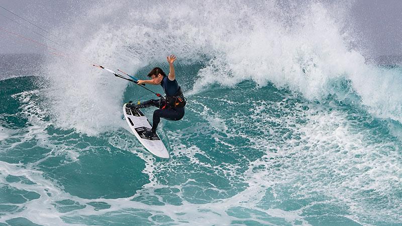 Reece Myerscough kitesurfing in wetsuit boots